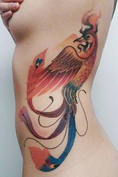exemple tatouage phoenix femme cotes et ventre