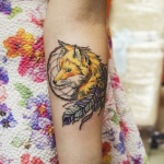 idee tatoo femme amerindien avec tete de renard et plume