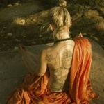 tatouage femme bouddha dos entier