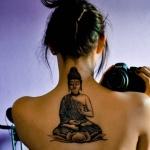 tatouage femme boudhisme thailandais centre haut du dos