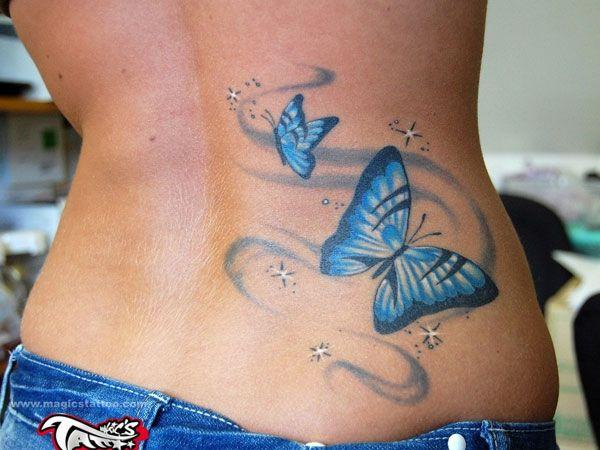 idee tattoo 2 papillons bleus femme bas du dos