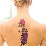 modele tatouage 2 papillons dans le dos avec fleurs centrees sur la colonne vertebrale