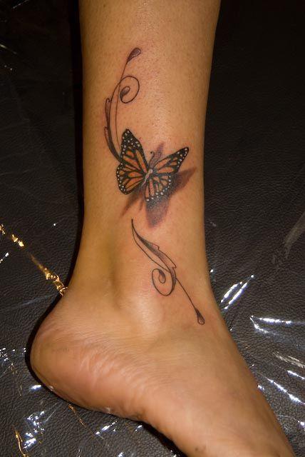 papillon monarque tatouage 3d femme mollet