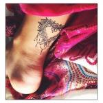 tatouage femme coeur cheville mandala