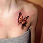 tatouage monarque femme sous clavicule