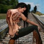 exemple tatouage femme ailes recouvrant le dos